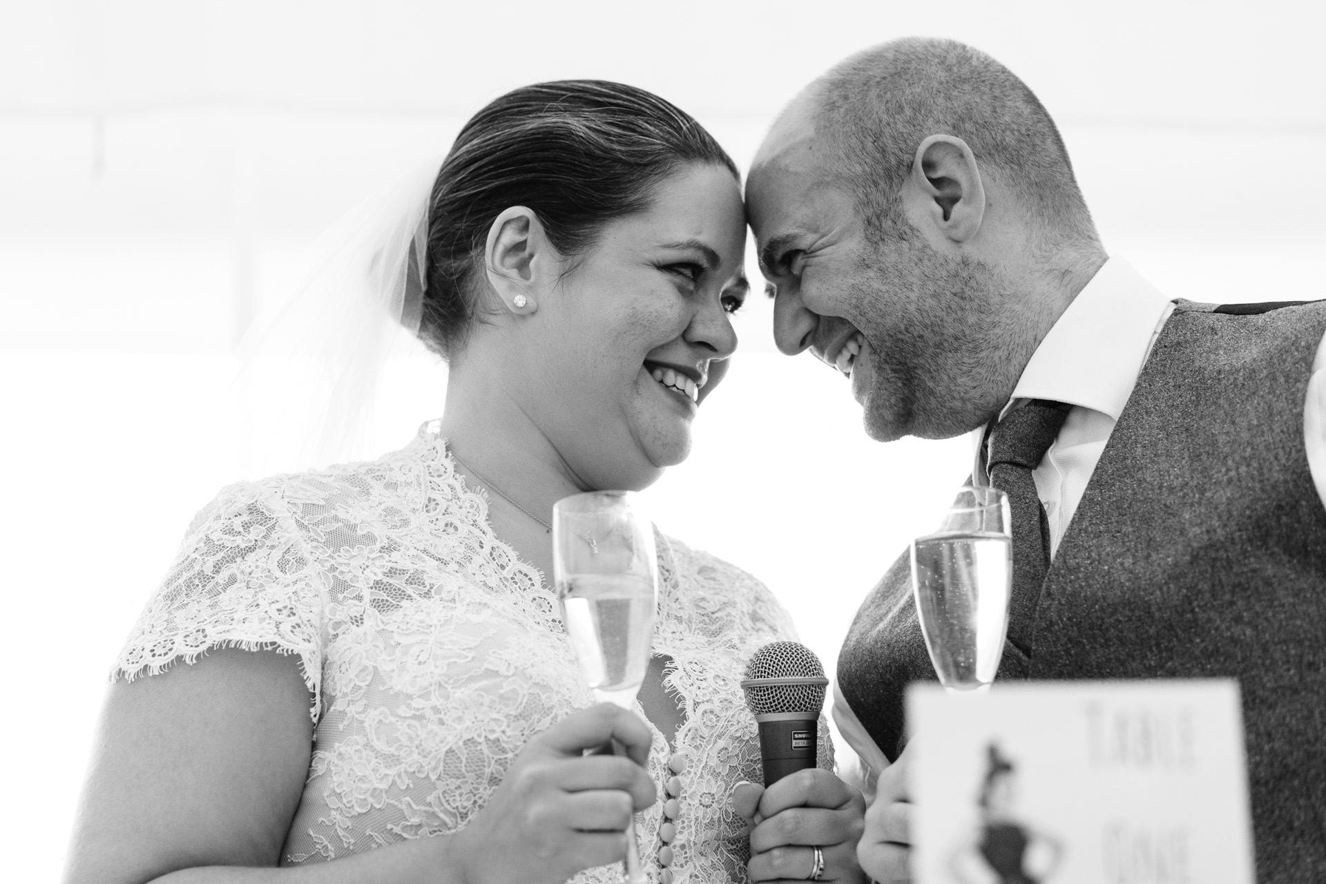 bride and groom during wedding speech