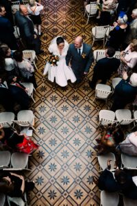 bride and groom leaving ceremony from above