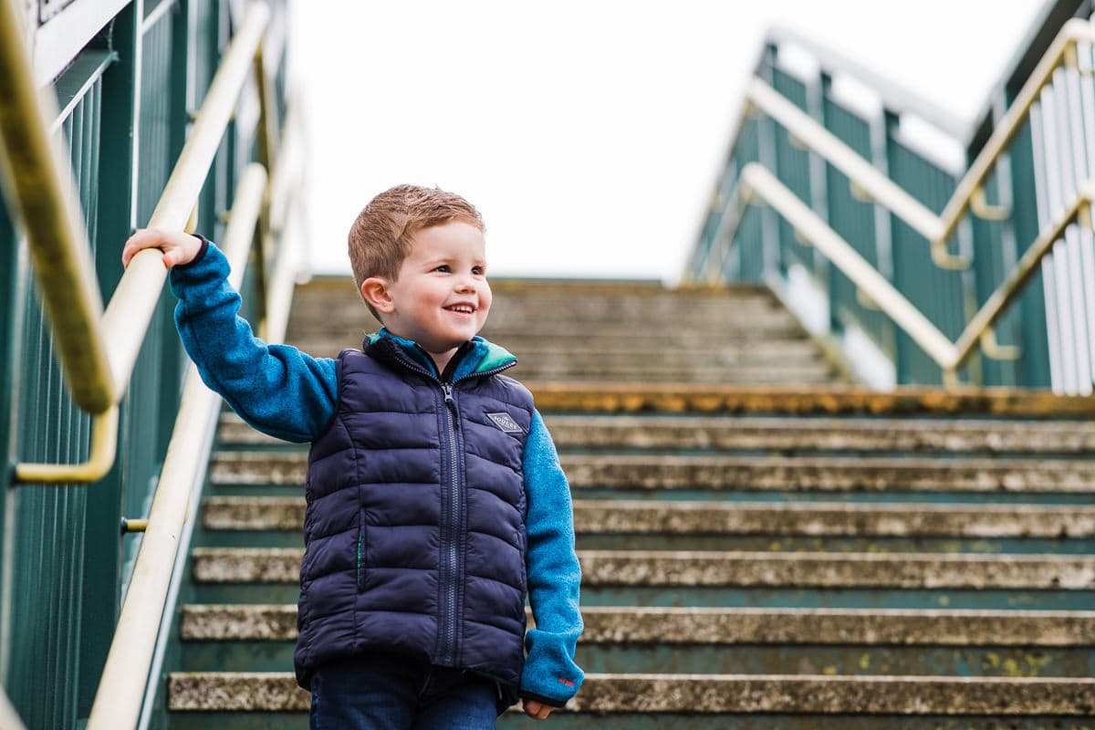 boy on railway bridge