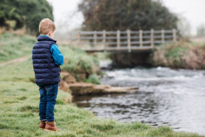 boy looking at river in Arlesey