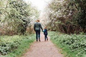 boy and mummy walking away