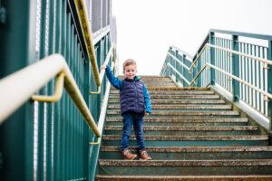 boy on railway bridge