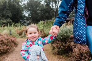 girl holding mummy's hand