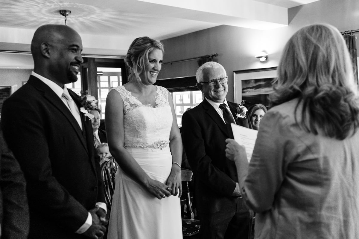 bride, groom and father at ceremony