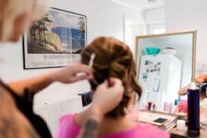 bridesmaid having hair done