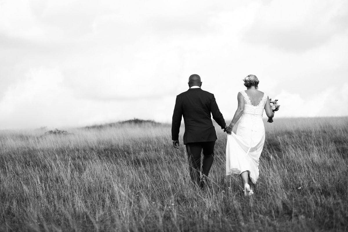 Bride and Groom walking at Bradbury Rings