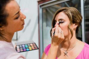 bridesmaid having eyeshadow applied