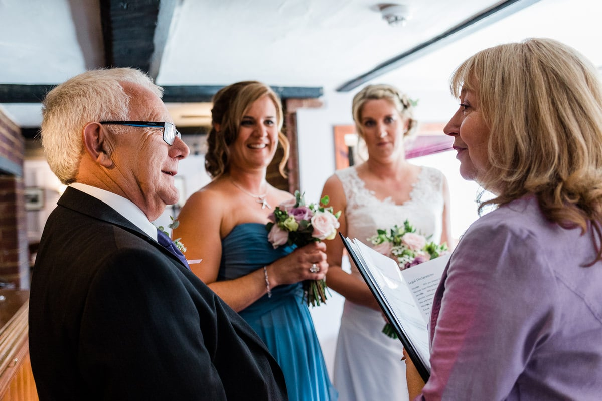 father of the bride talks to registrar