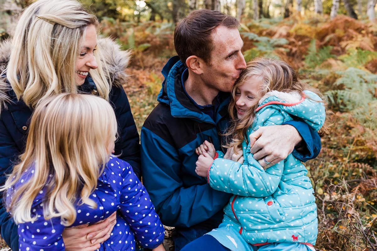 family in autumn leaves in Bedfordshire