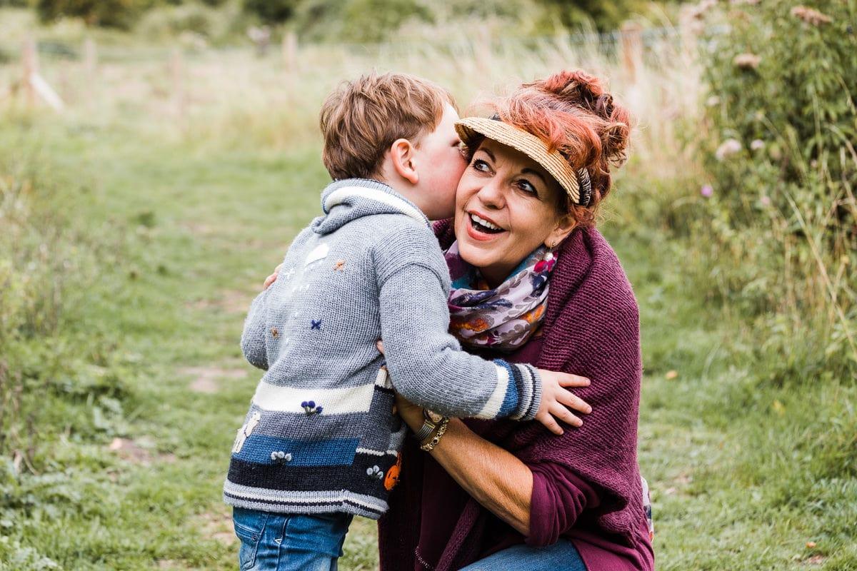 boy whispering to his gran
