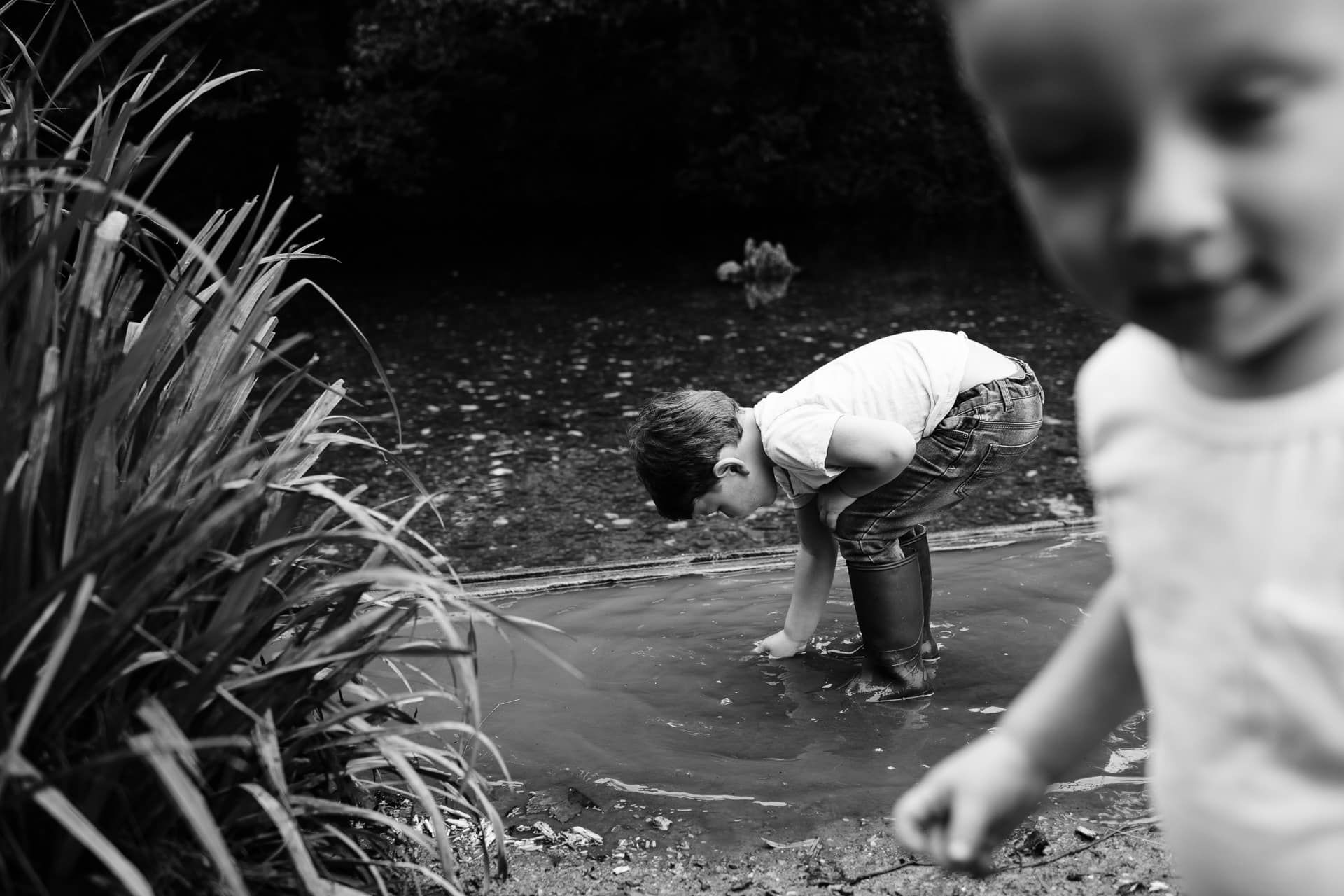 Brothers playing in stream