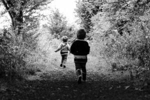 Boys running in woods