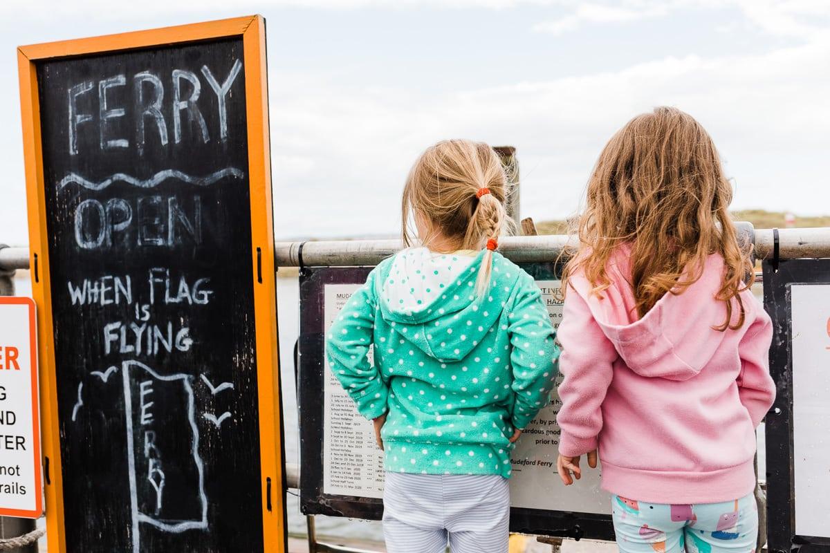 girls waiting for Mudeford ferry