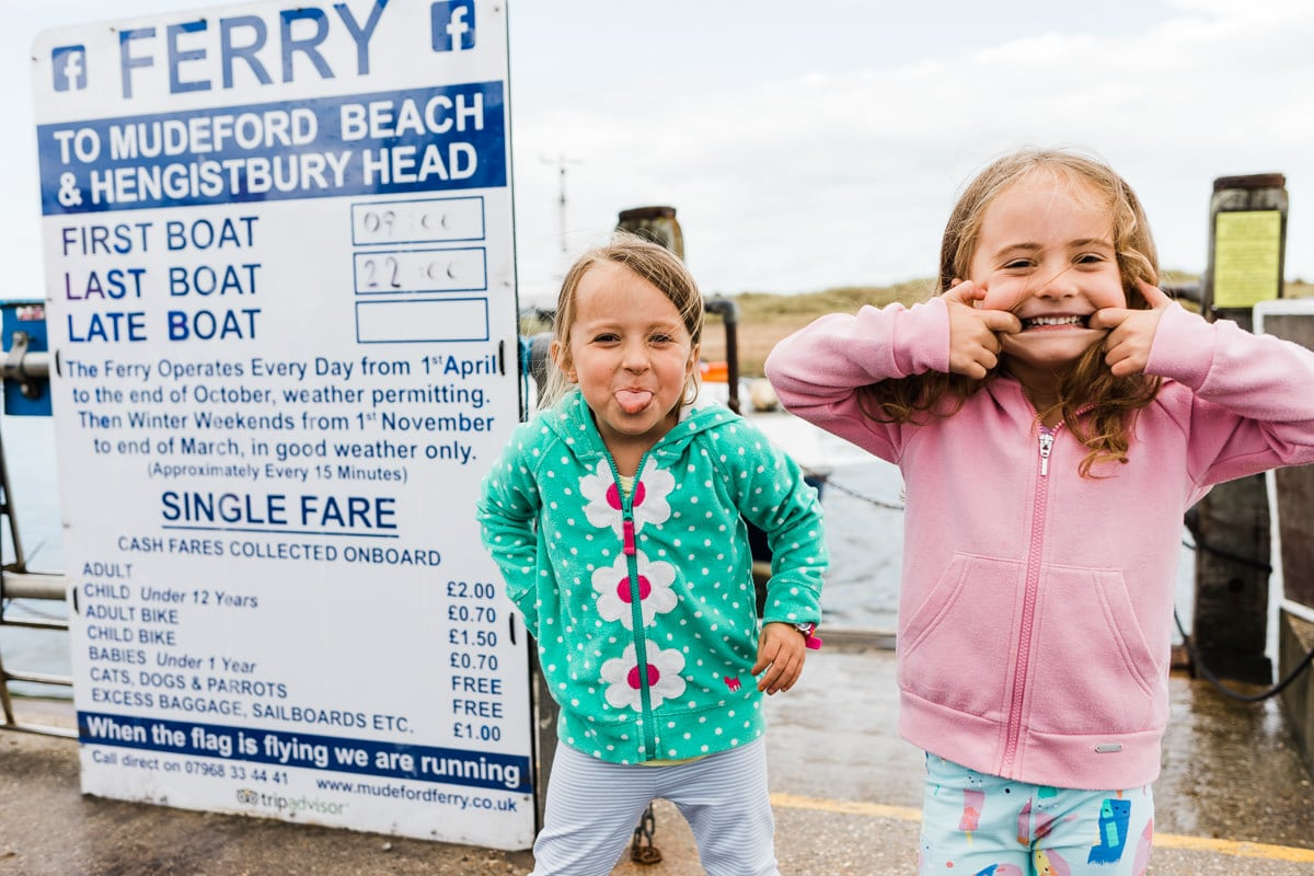 girls pulling faces at Mudeford