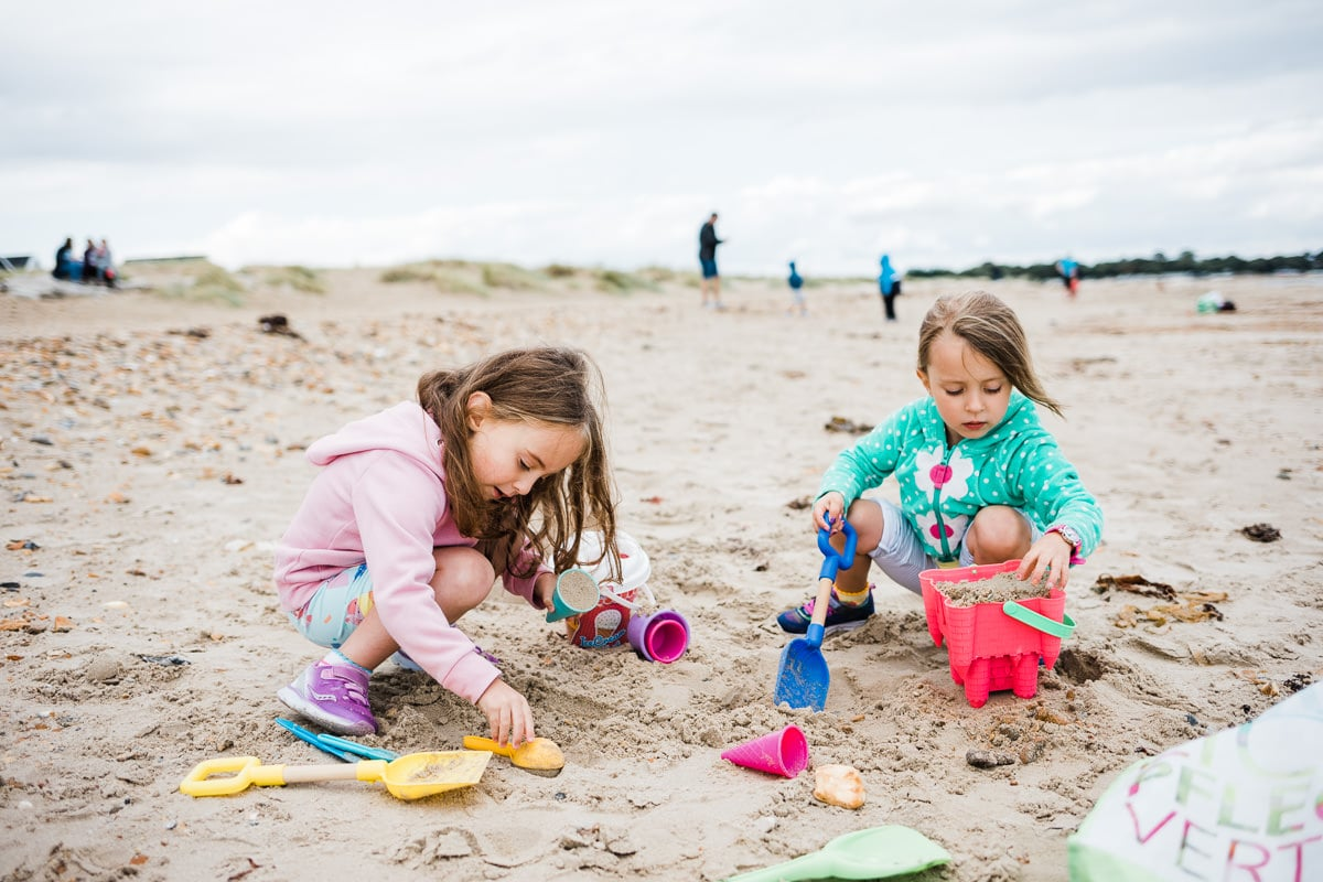 girls playing in the sand
