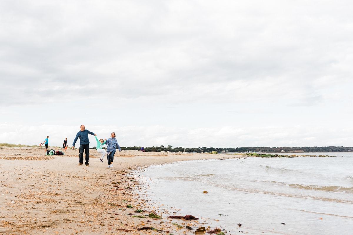 family walking at Mudeford