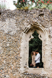 engaged couple in ruined church window