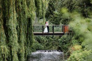 couple on bridge at Jordan's Mill