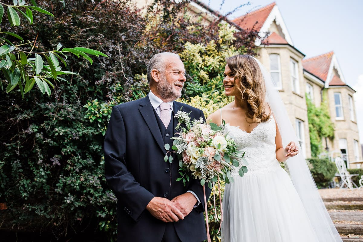 bride awith father before wedding at Lodge Farm House Hitchin