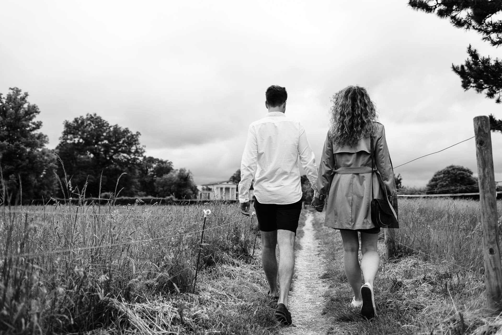 couple walking on engagement shoot