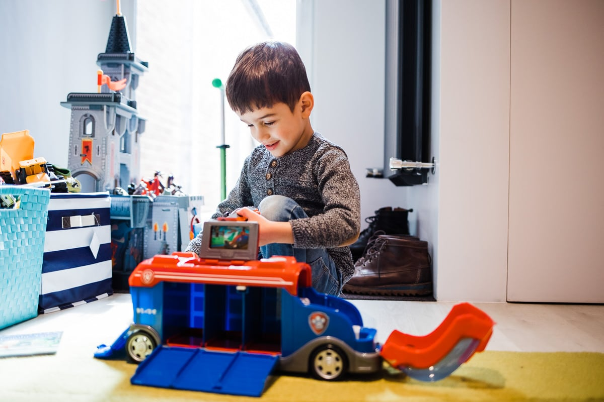 boy playing with truck