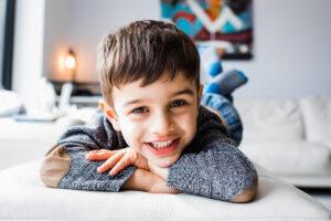 portrait of boy n windowlight at home