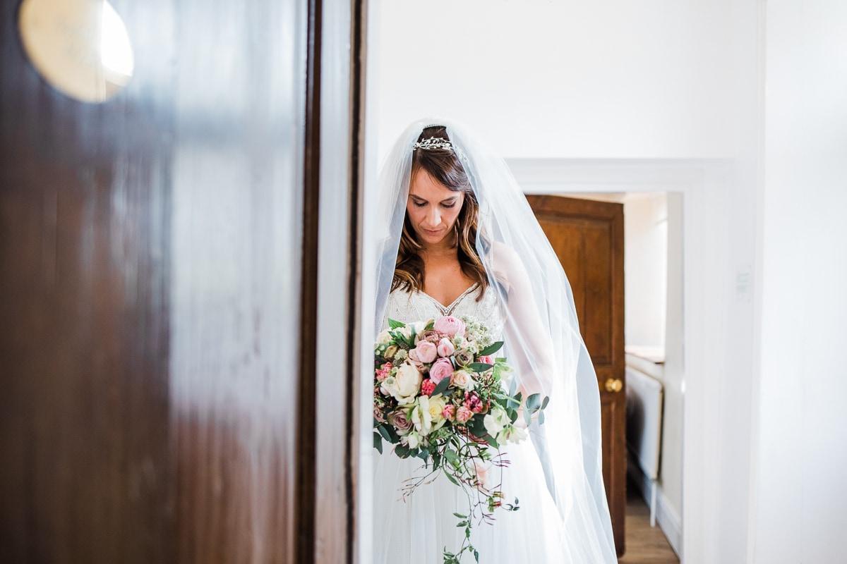 bridesmaids seeing bride in her dress