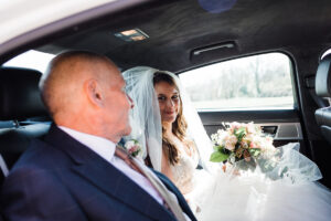 bride and father in wedding car