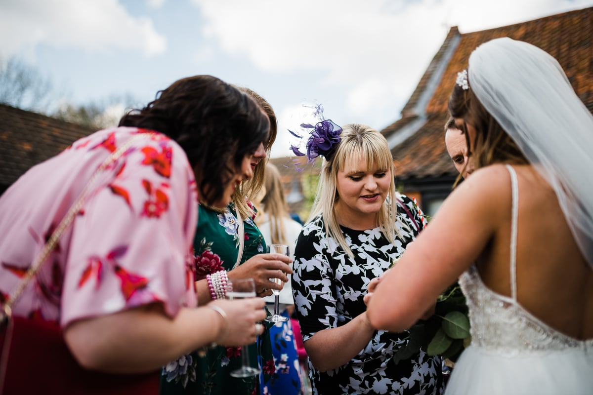 guests look at the brides wedding ring