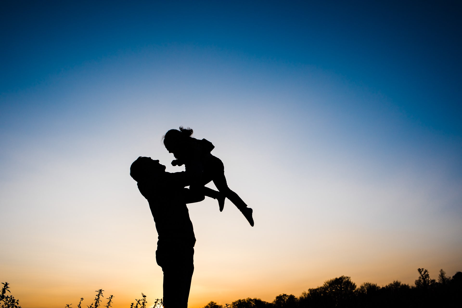 silhouette photo of a Daddy and daughter at Trumpington Meadows
