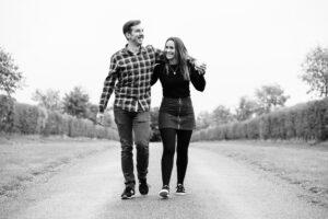 engaged couple walking at Hunters Hall