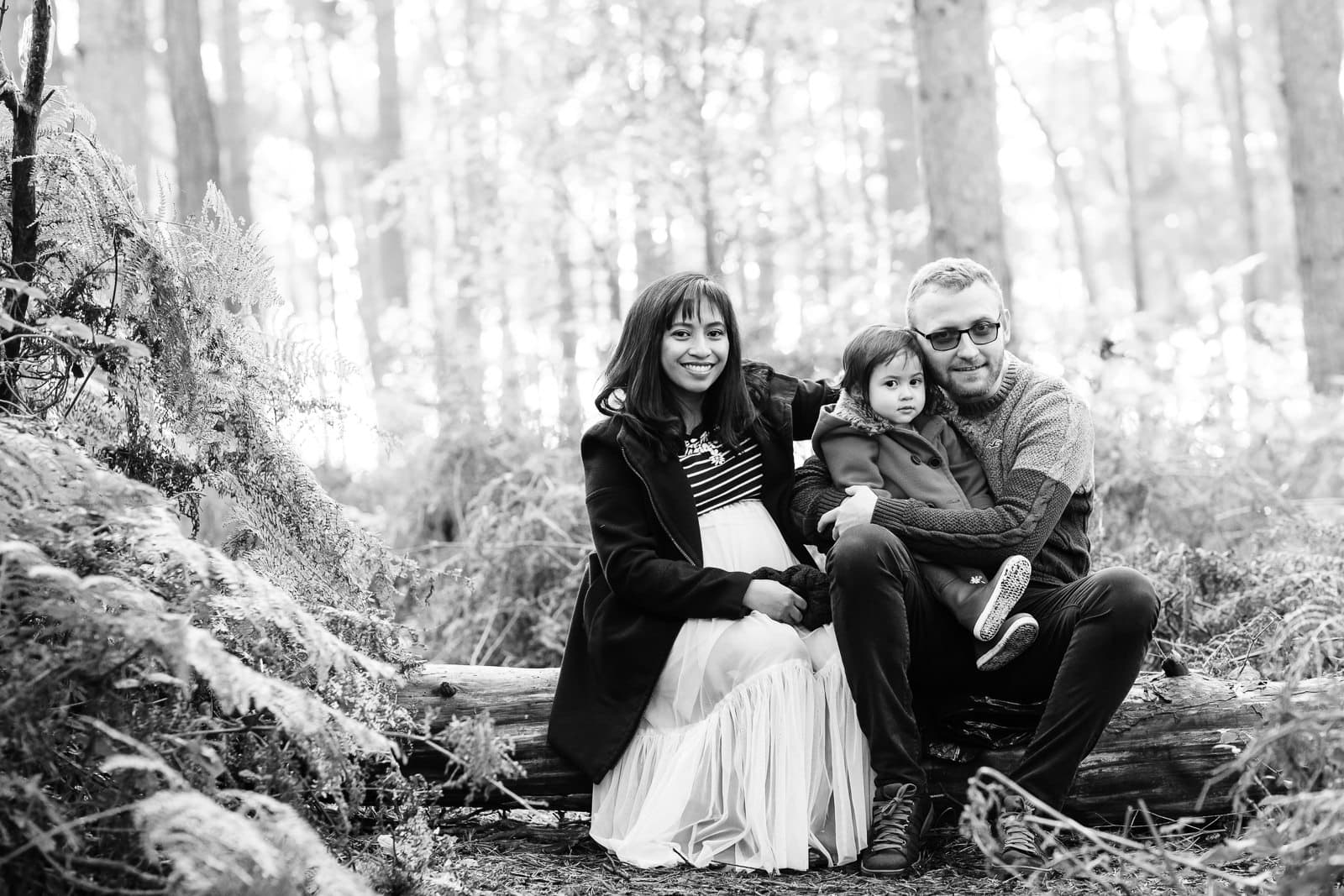 image of family of three on a Bedfordshire woodland family photoshoot