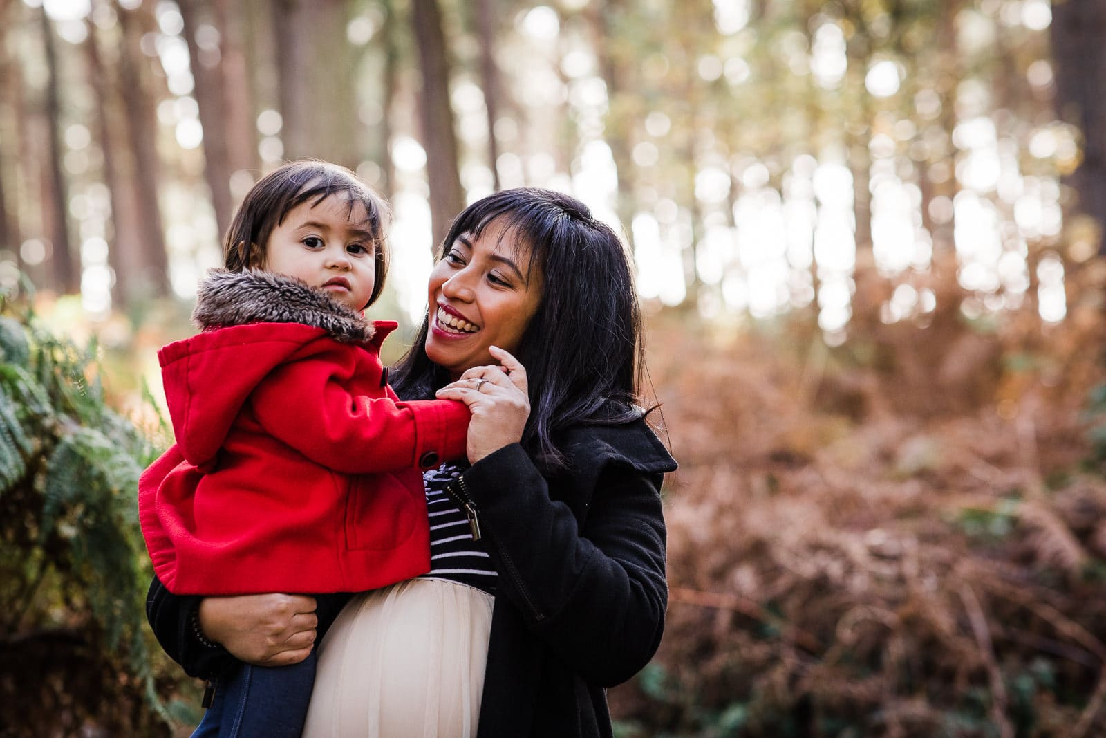 Mummy and daughter in the woods