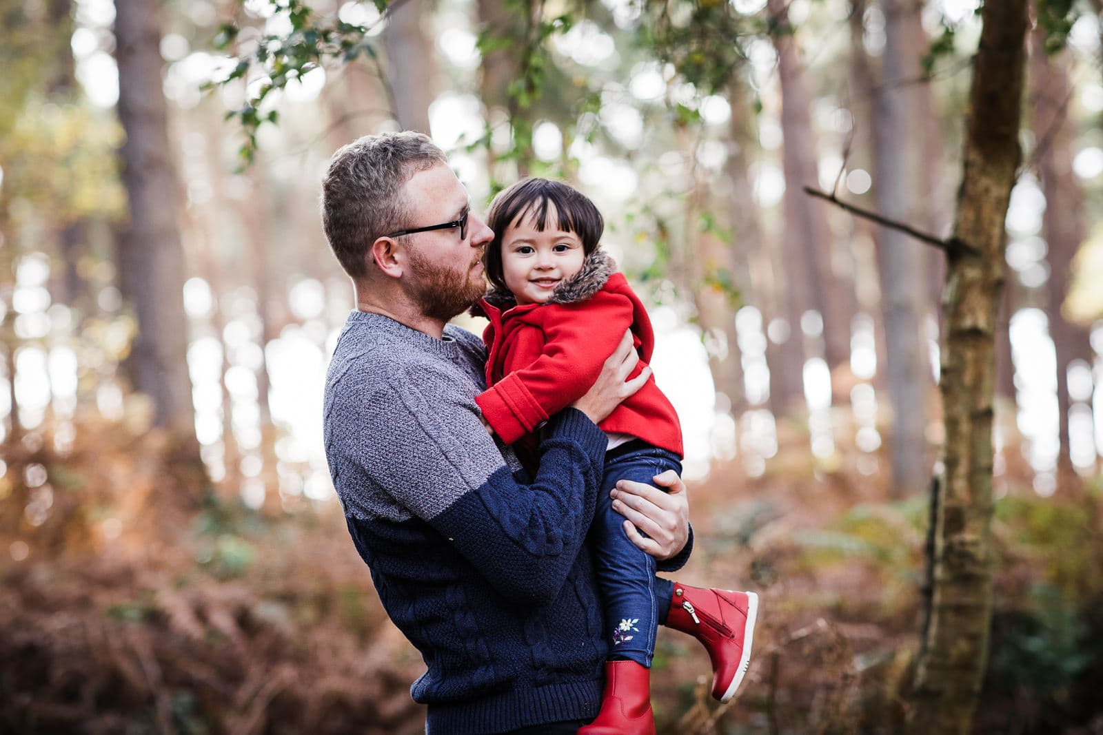 daddy and daughter in the woods