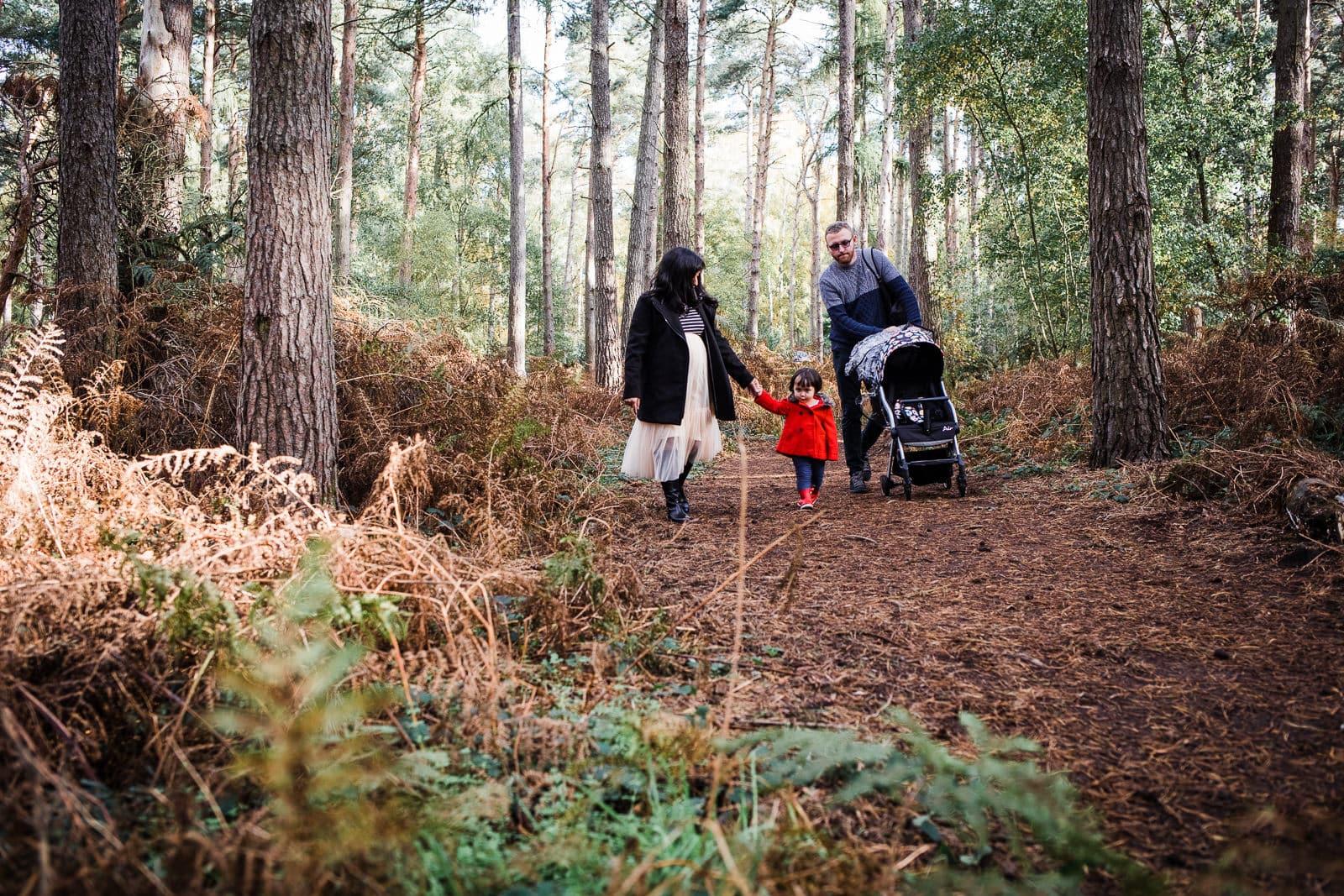 family of three walking at Rowney Warren