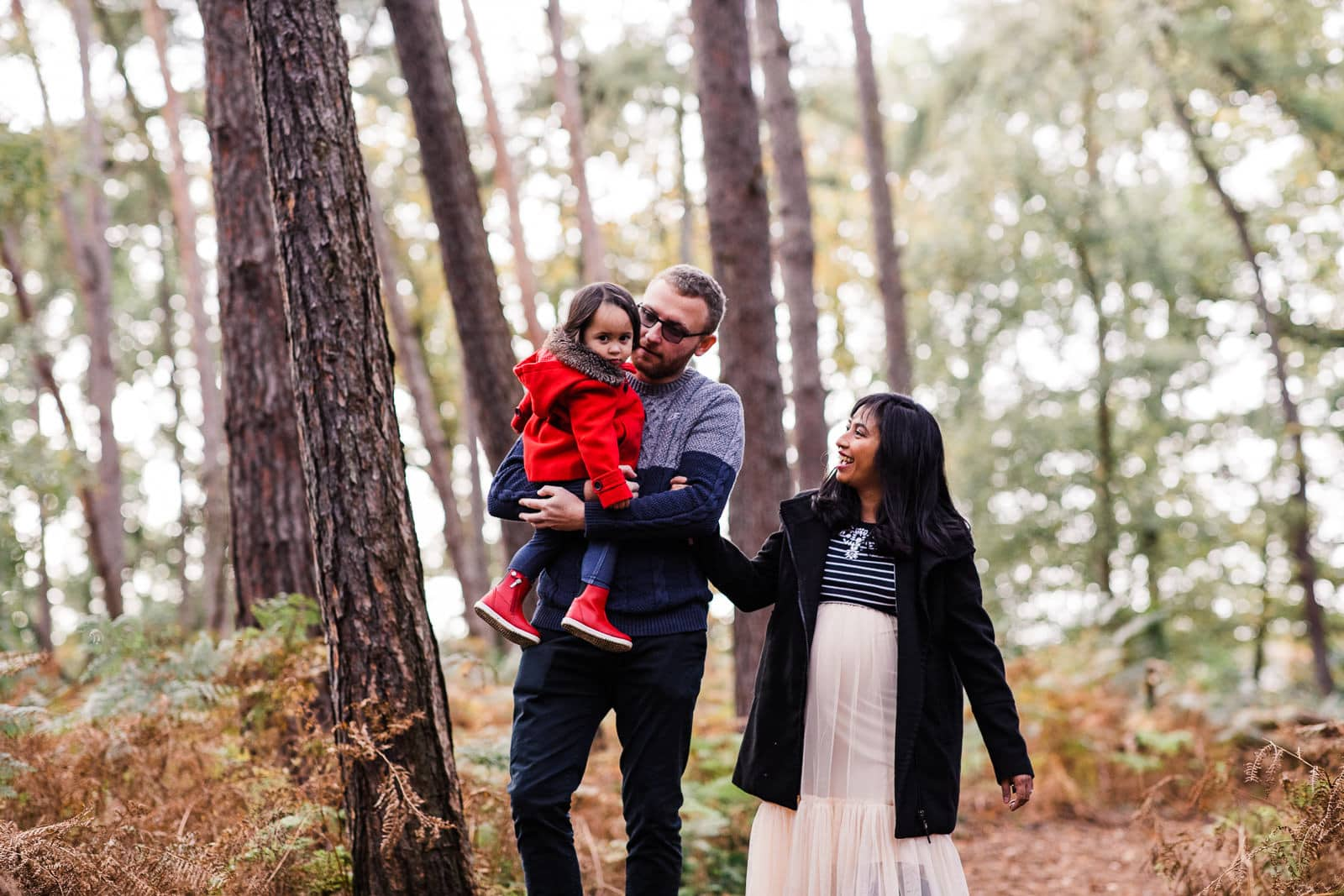 family of three walking in the Bedfordshire woods