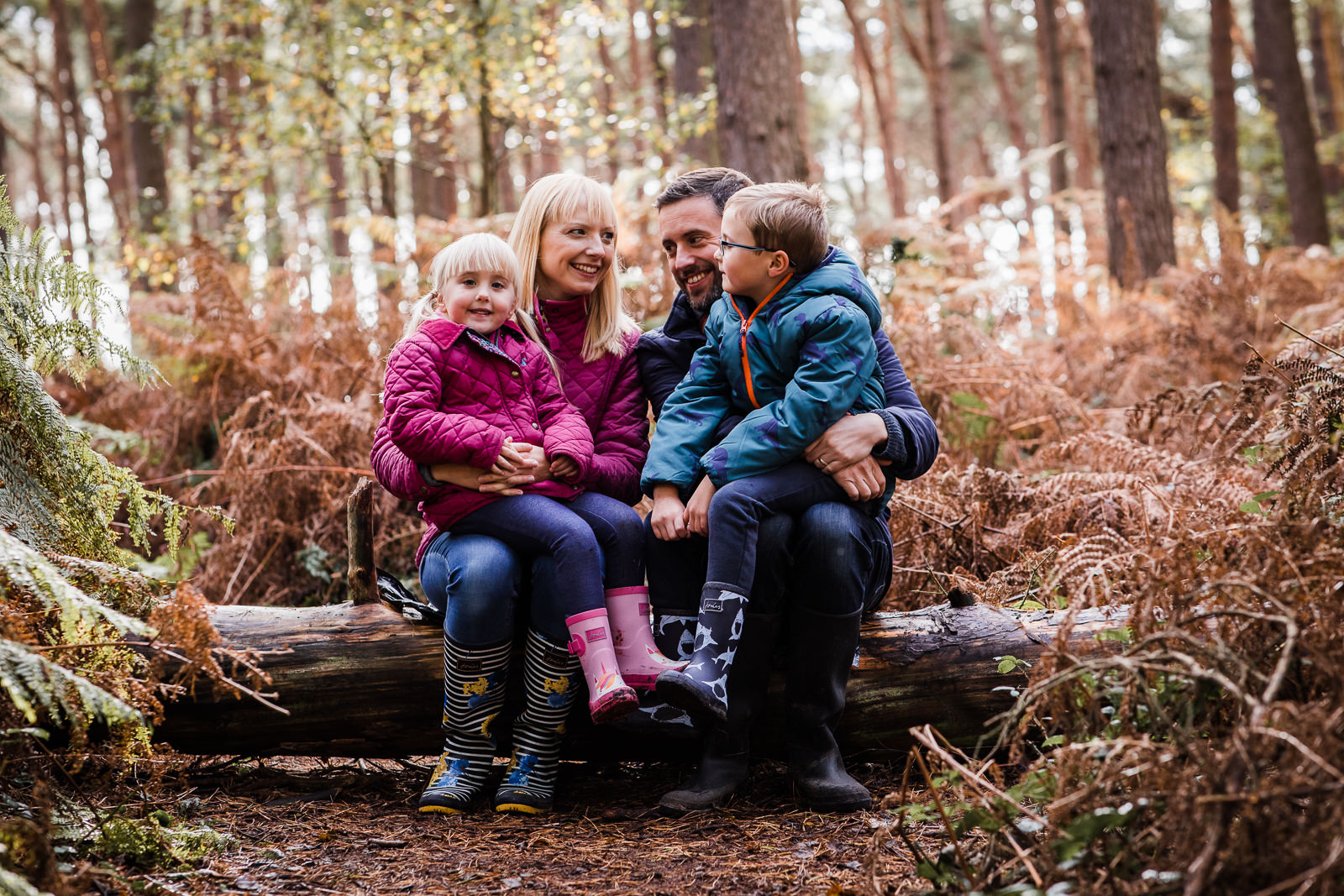 family of four in the woods