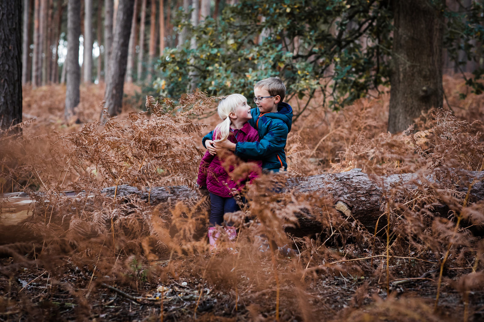 brother and sister in the woods