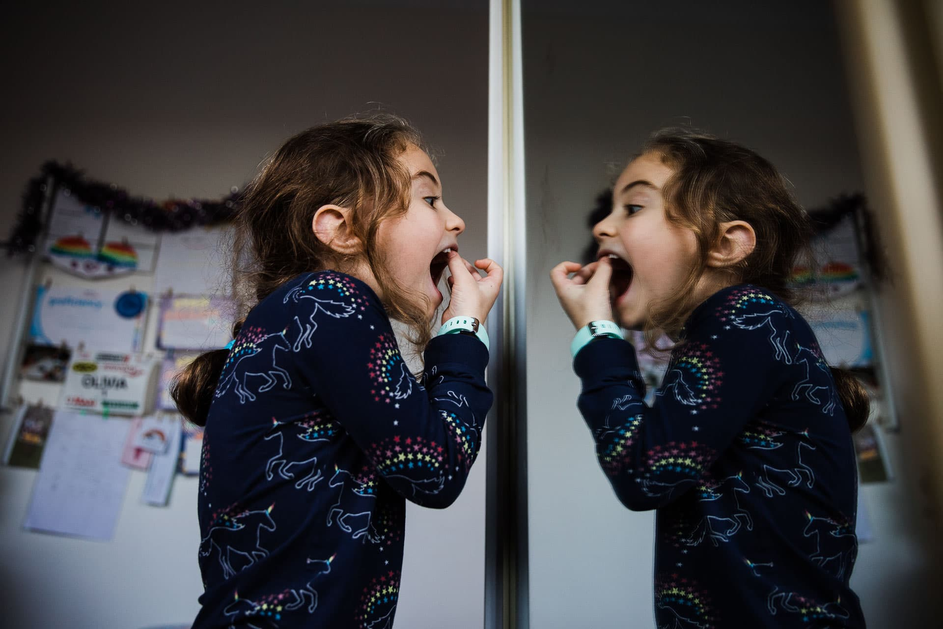 girl pulling wobbly tooth